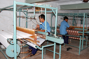 Blind students weaving Bedsheets on handloom machine