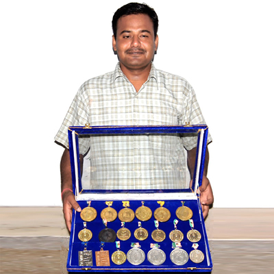 Blind student Anand Chowdhary with various winning Medals